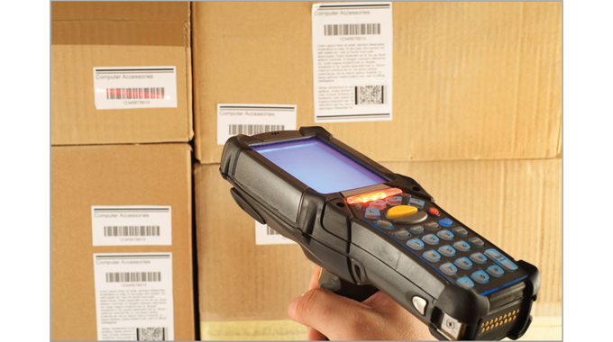 Fig. 5.8 A hand-held scanner being used to read barcodes in a warehouse