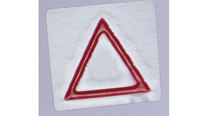 Figure 10.5 - Tactile Warning Triangle on labels with hazardous contents – used for the blind or vis