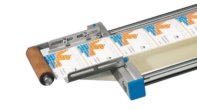 Figure 2.11 - Use of a roller to press the label to the product or pack. Courtesy of Herma