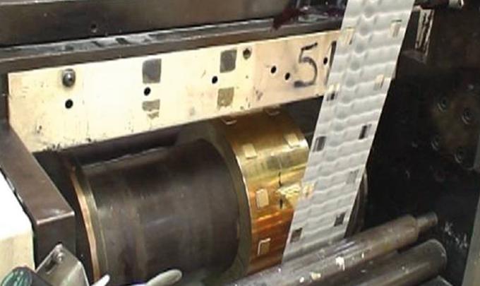 Figure 2.12 - Sleeved segmented brass die (curved)