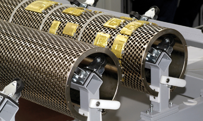 Figure 2.13 - Segmented die - curved brass foiling dies mounted onto a rotary honeycomb base