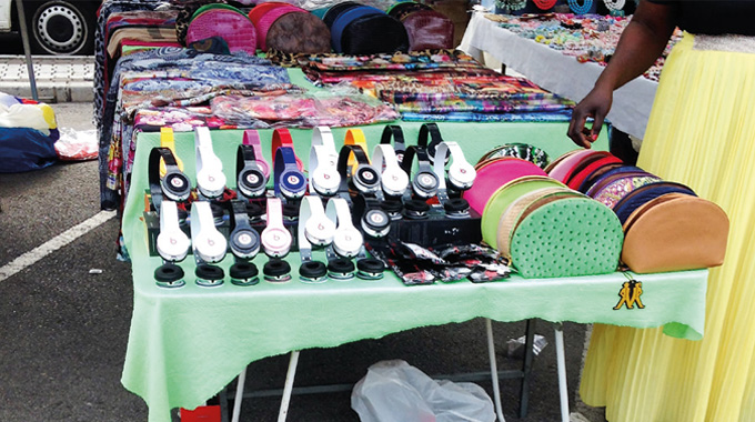 Figure 2.1 - Counterfeit headphones and purses openly on sale at a street market in Spain (2014)
