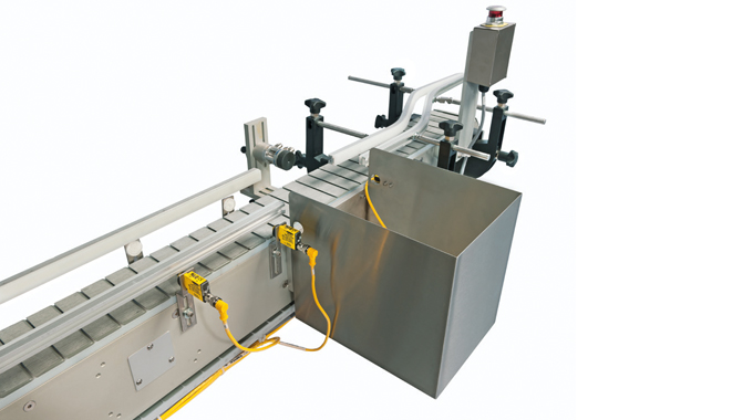Figure 2.23 - Sensing devices used as part of a product ejection process. Photo courtesy of Accraply
