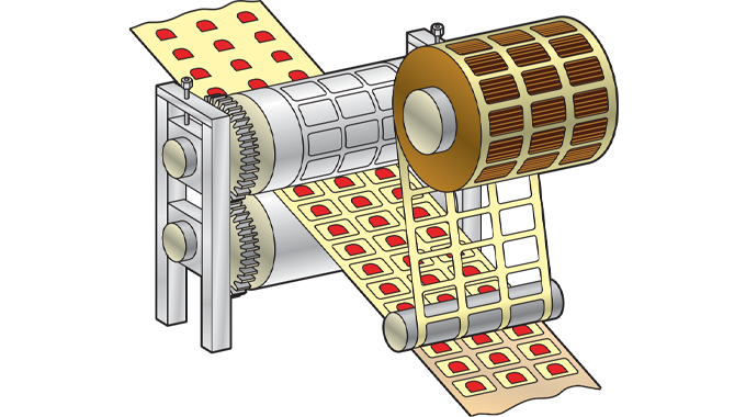 Figure 2.3 - Matrix waste being removed and re-wound after die-cutting