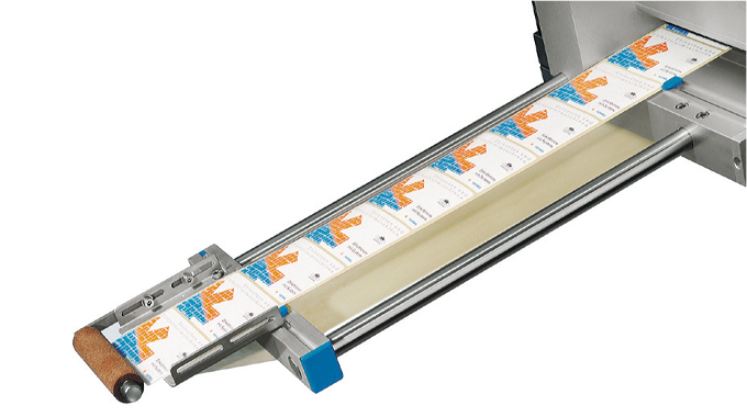 Figure 4.19 Use of a roller to press the label to the product or pack. Source- Herma