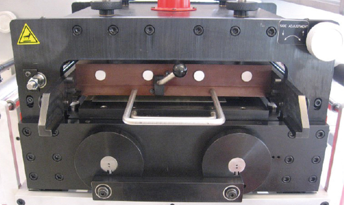 Figure 4.5 - Flatbed embossing unit