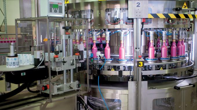 Figure 7.8 - ILTI linerless applicator on a production line