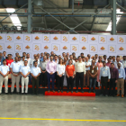 The SMI team with clients at the factory tour