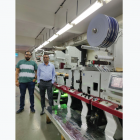 L-R: Uday Lodha and Prasanna Sahu of Barcom Industries in front of the Mark Andy Performance Series P5 press