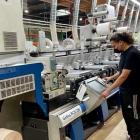 ASL Print FX press operator with Gallus RCS 330 at its Napa location