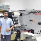 Niraj Darji, president of Astron Packaging (L) inspects ABG Digicon Series 3 with Nitin Thakur of Vinsak