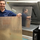 Luke Vassiliades, vice president of administration and finance at McCracken Label demonstrates the company's new Fujifilm Flenex FW water-washable plate system