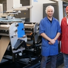 L-R: Tobias Grolimund, head of production and Marcel Häsler, COO at Birkhäuser, in front of the new Gallus Labelfire with low migration equipment.