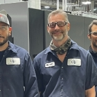 Fort Dearborn Company team members from left to right: Rosendo Pozos and Brent Baldwin, press operators and Mike Suarez, maintenance technician