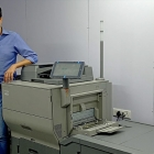 Nishant Sethi, CEO, Redray Global, in front of the newly installed Ricoh Pro C5300S digital print production system