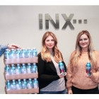 INX representatives Bryce Kristo, Michelle Pack, Dayna Campobasso and John Hrdlick ready the supply of water being shipped to Texas to help with relief efforts.