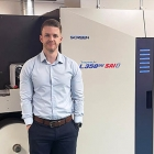 Nathan Williams, operations manager at Limpet Labels in front of newly installed Screen L350UV SAI S 7-color press