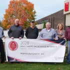 Jon Bauch (third from left) and Martin Automatic's Safety Committee display the 2020 Dale Sabers Safety Award plaque and banner