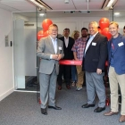 Global Graphics chairman of the board, Guido van der Schueren, accompanied by Mike Rottenborn, CEO, cut the ribbon to open the Meteor Inkjet's new facility