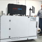 L-R: Mr. Ionut Buhagiar and Dan Preda, partners at PlusPrint in front of the newly installed Jetsci ColorAqua full-color digital press