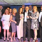 Representatives from the Sandon Global management, operations and customers services teams receiving the 'Business of the Year' award.