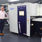 Steve Baker, managing director of Baker Labels with new press