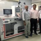 Bhavya Shah (left) and Manish Patel (right) of Shreedhar Labels with Amit Desai of Baldwin Vision Systems, and the Guardian PQV 100 percent inspection system installed on their Re brand rewinder.