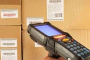 A hand-held scanner being used to read barcodes in a warehouse
