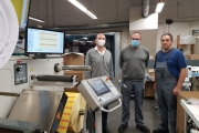 L-R: Peter Neudecker of Erhardt+Leimer with Knut Schulzke, head of production, web-fed printing division at Oscar Mahl, and machine operator Ciprian Virca in front of the Omet XFlex X6 equipped with a SmartScan UV inspection