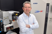 Rod Fisher, managing director of Print-Leeds, in front of the newly installed Screen press