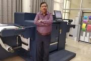 Sandeep Juneja, owner of Pinnacle Traxim, with the new Konica Minolta AccurioLabel 230 digital press