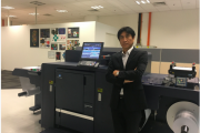 Makito Nakamura, division head of PP & IP Business, in front of the Accurio Label 190 digital press