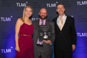 Kristin Yerecic Scott, Brian Hurst and Josh Yerecic accepted the company's first World Label Award