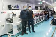 Tengcai Technology CEO Peng Hanwen (right) and Labelexpo senior account manager Daniel Zhao with the Hongsheng HSR flexo press