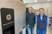 David Hotchkiss, left, and AJ Buran with their HP Indigo 20000 digital press