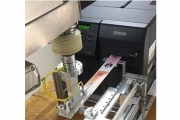 Epson has partnered with United Automation to engineer two on-demand, color print-and-apply applicators for pharmacy bottle and bag labeling integrating