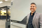Anil Namugade, managing director, Trigon Digital with the new HP Indigo 25K digital label printing press