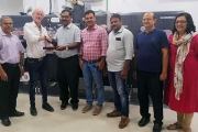 Xpress Labels team and Renil Thomas - Xpress Labels Managing Director shaking hands with Ib Reker Andersen – GM Senior Field Engineer.