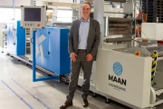 Robert Bongertman, commercial director at Belona in a front of the recently installed Linerless Label Line from Maan Engineering