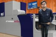 Akshat Jain, director of Bahubali Digiglam in the front of newly installed Konica Minolta MGI Jetvarnish 3D One