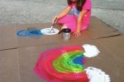 Vicki Strull's daughter, Eden, reusing an empty furniture box as a canvas