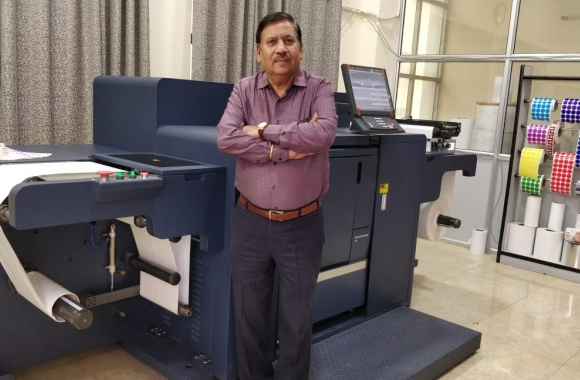 Sandeep Juneja, owner of Pinnacle Traxim, with the new Konica Minolta AccurioLabel 230 digital press