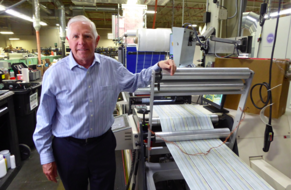 Joel Carmany, president of Consolidated Label, with his latest Nilpeter FA press