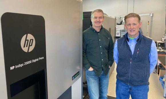 David Hotchkiss, left, and AJ Buran with their HP Indigo 20000 digital press