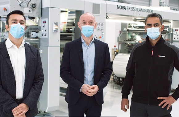 L-R: Ivano Andrighetto, product sales specialist, laminating; Nanni Bertorelli, product line manager, coating and laminating; and Damiano Zinelli, process laminating specialist, in front of the Bobst Nova SX 550 laminator.