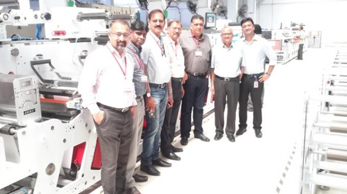 Amit Ahuja and his father (extreme right) , Sudhir Samant (centre) with the Modern Lithographic team at the Multitec factory in Faridabad