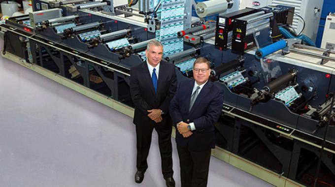Control Group owners Bill Cheringal (left) and Jeff Levine (right) with the company's latest Nilpeter press