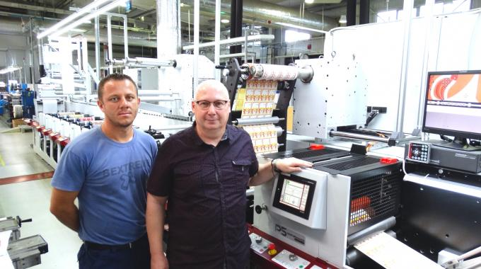 Sunimprof Rottaprint press operator Cosmin Popa (left) with the printer's digital print manager, Zsolt Veres (right), and the latest Mark Andy