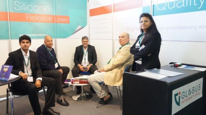 Harsh Doshi, co-director at Globus International (extreme left) with his team and some customers at the company stand at Labelexpo Europe 2015