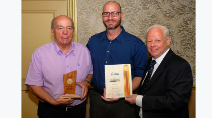 Mark Andy's local partner, SArepco's Paul Bouwer (right), presented KB Labels' Bill Jordaan and Robert du Preez with a gold medal for the Nando's Lemon & Herb PS label